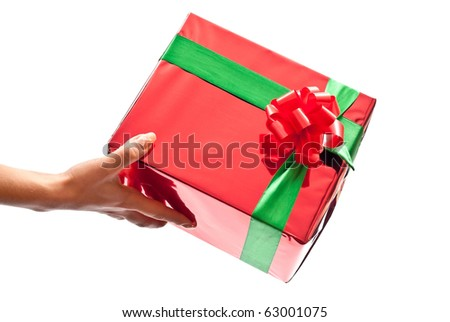 Woman's hand with a small red gift box isolated on white background. Focus on bow - stock photo