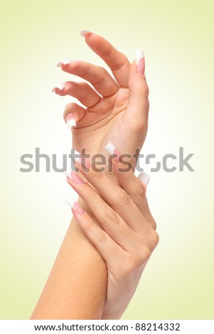 Woman's hand with French manicure - stock photo