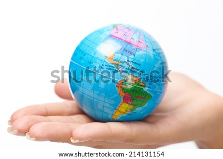 woman's hand with globe - stock photo