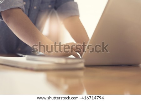 woman's hand with laptop computer notebook, selective focus and vintage tone