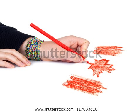 Woman's hand with pencil draws the flag of Canada, isolated