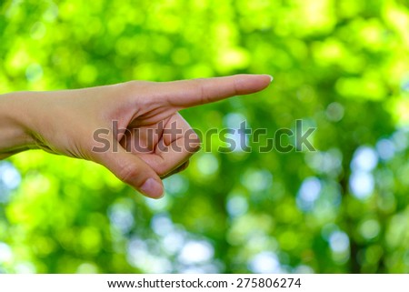 Woman's hand with pointing finger.