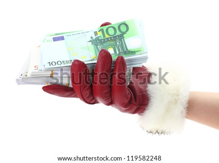 Woman's hand with red glove holding gift of money - stock photo
