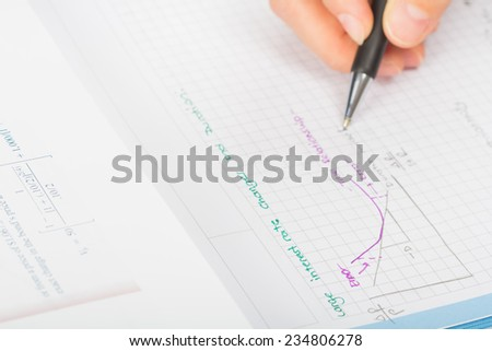 woman's hands a pen, financial statement accounting - stock photo