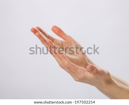 Woman's hands asking for help - stock photo