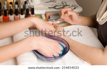 Woman's hands at manicure procedures