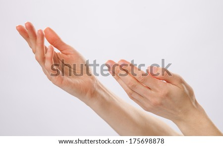 Woman's hands begging to help - stock photo