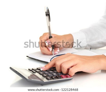 Woman's hands counts on the calculator, on white background close-up - stock photo