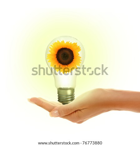 woman's hands holding shiny lamp - stock photo