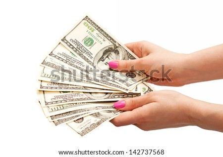 Woman's hands holding 100 US dollar banknotes, isolated on white background