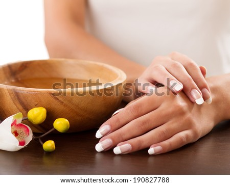 Woman's hands lying on the table - stock photo