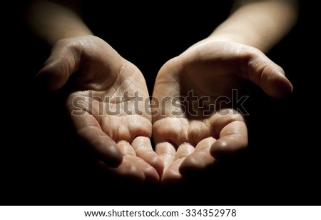 Woman's hands on black background