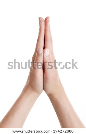 Woman's hands praying against on white background