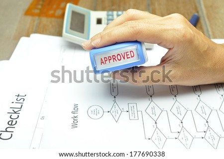 woman's hands put the stamp on documents - stock photo