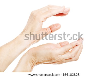 Woman's hands shaped to hold copy space between them. Isolated on white.