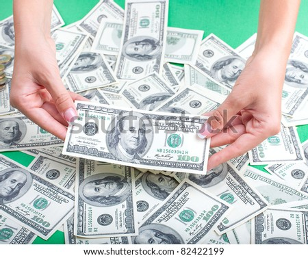 woman's hands show the money - stock photo