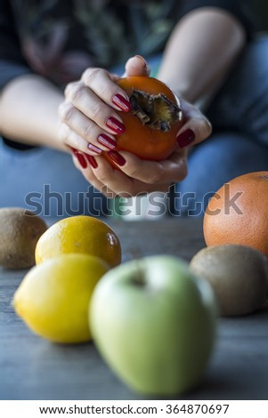 Woman's hands takes a fresh fruit