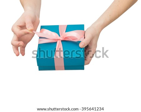 woman's hands unboxing giftbox - stock photo