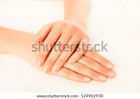 Woman's hands with beautiful manicure isolated on white background.