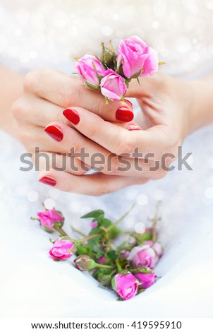 Woman's Hands with Bouquet of Roses. Beautiful Manicure. Beauty and Fashion Concept. Health Care