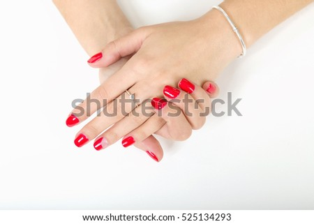 woman's hands with painted nails on a white background.