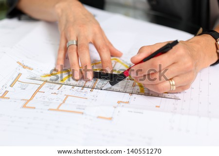 woman�´s hands with pencil and construction plan - stock photo