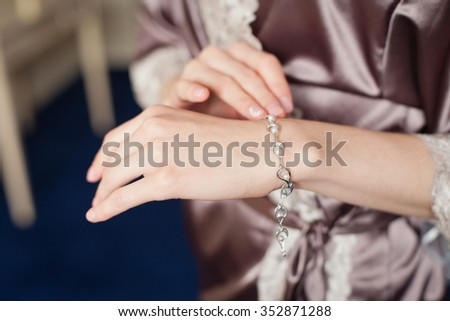 Woman's hands with perfect manicure with silver bracelet