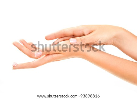 woman's hands with pink care cream on the forefinger - stock photo