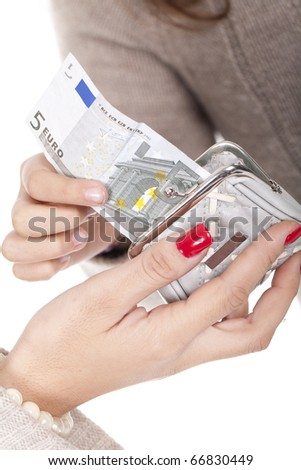 Woman's hands with purse and money