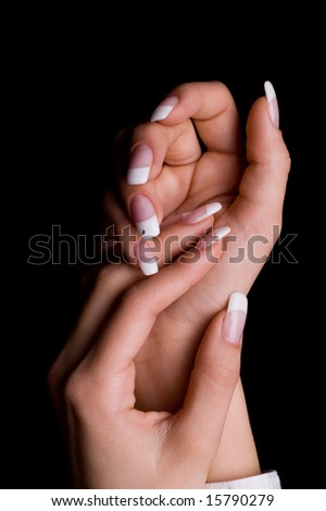 woman's hands with white manicure - stock photo
