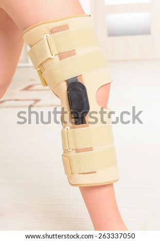 Woman's leg in knee cages for stabilization and support - stock photo