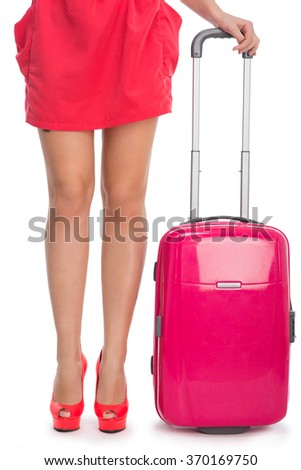Woman's legs in high heel shoes and a suitcase - stock photo