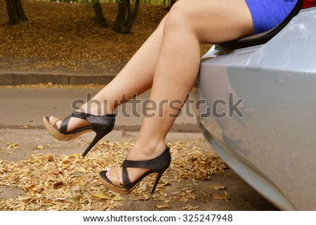 Woman's legs sticking out of a trunk
