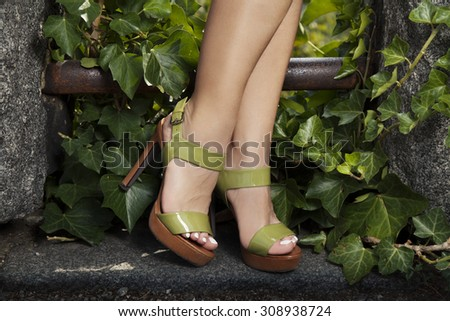 woman's legs wearing green sandals, outdoor shoot