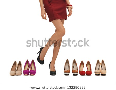woman's long legs with high heels and shoes. - stock photo
