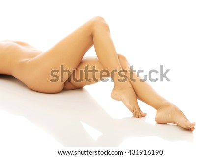 Woman's nude legs, buttock and slim belly - stock photo