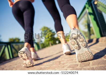 Woman's running shoes closeup at the park