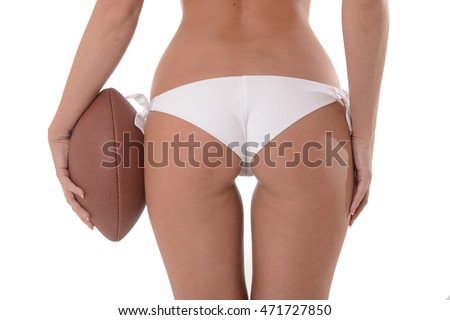 Woman's sexy Backside holding a football