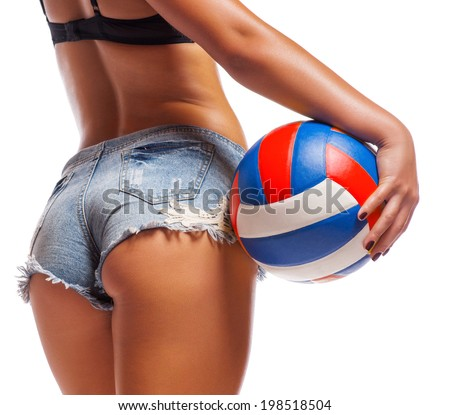Woman's Sexy Backside Holding a Soccer Ball - stock photo