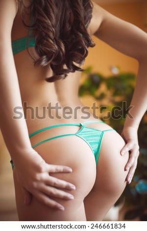 Woman's sexy buttocks in a bikini - stock photo