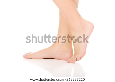Woman's smooth bare feet with pedicure. - stock photo