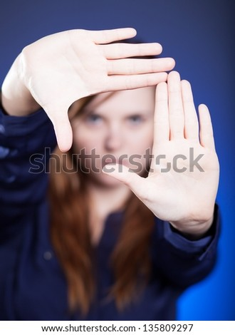 Woman's two hands framing composition forming space