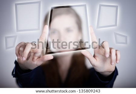 Woman's two hands pointing button on touch screen