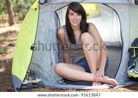woman sat in tent - stock photo
