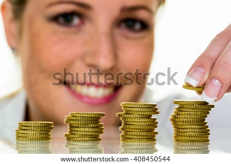 woman save with stack of coins for money