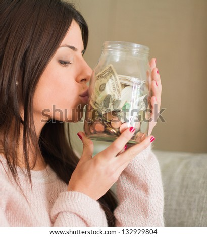 Woman Saves Money And Coins For The Future, Indoors - stock photo