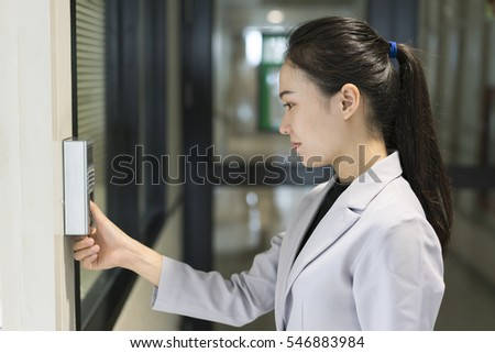 Woman scanning finger print for enter security system