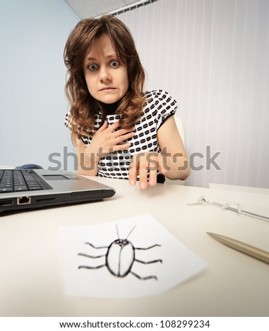 Woman scared cockroach drawn on paper - stock photo
