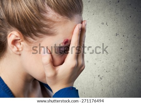 Woman. Scared young girl covering her face. Child abuse. - stock photo