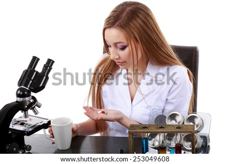 woman scientist who takes pills for migraine - stock photo